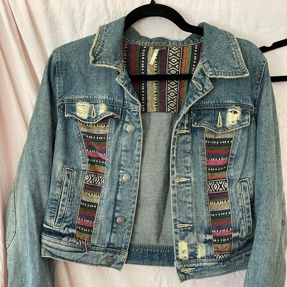 Free People distressed jean jacket size 4